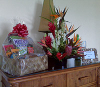 Honeymoon tropical arrangment, munchies gift basket and message in shell frame.