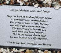 Personalized message in handmade shell frame for honeymooners.