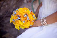 Maui wedding bouquet, round with orange roses, yellow calla lilies and Tiffany blue hydrangeas